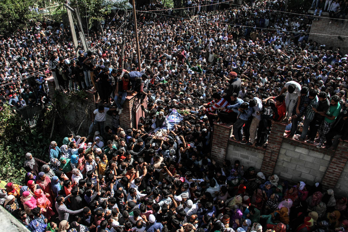 Another funeral procession of a slain rebel attended by hundreds of Kashmiris. Instances of people surrounding encounter sites and throwing stones on Indian troops to allow trapped rebels to escape have increased in recent years. [Sameer Mushtaq/Al Jazeera]