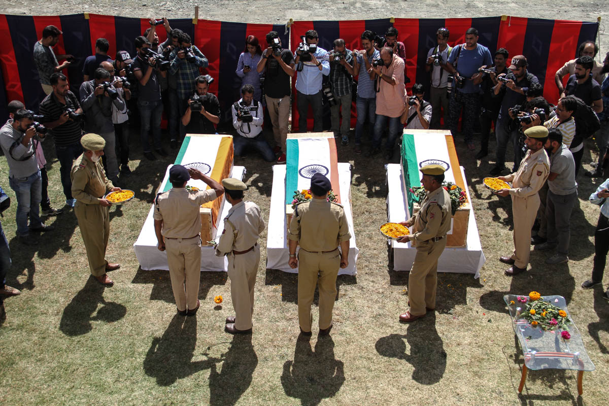 Tributes being paid to policemen who were abducted and killed by rebels in South Kashmir, another recent trend. Nearly 40 policemen were killed across Kashmir this year. [Sameer Mushtaq/Al Jazeera]