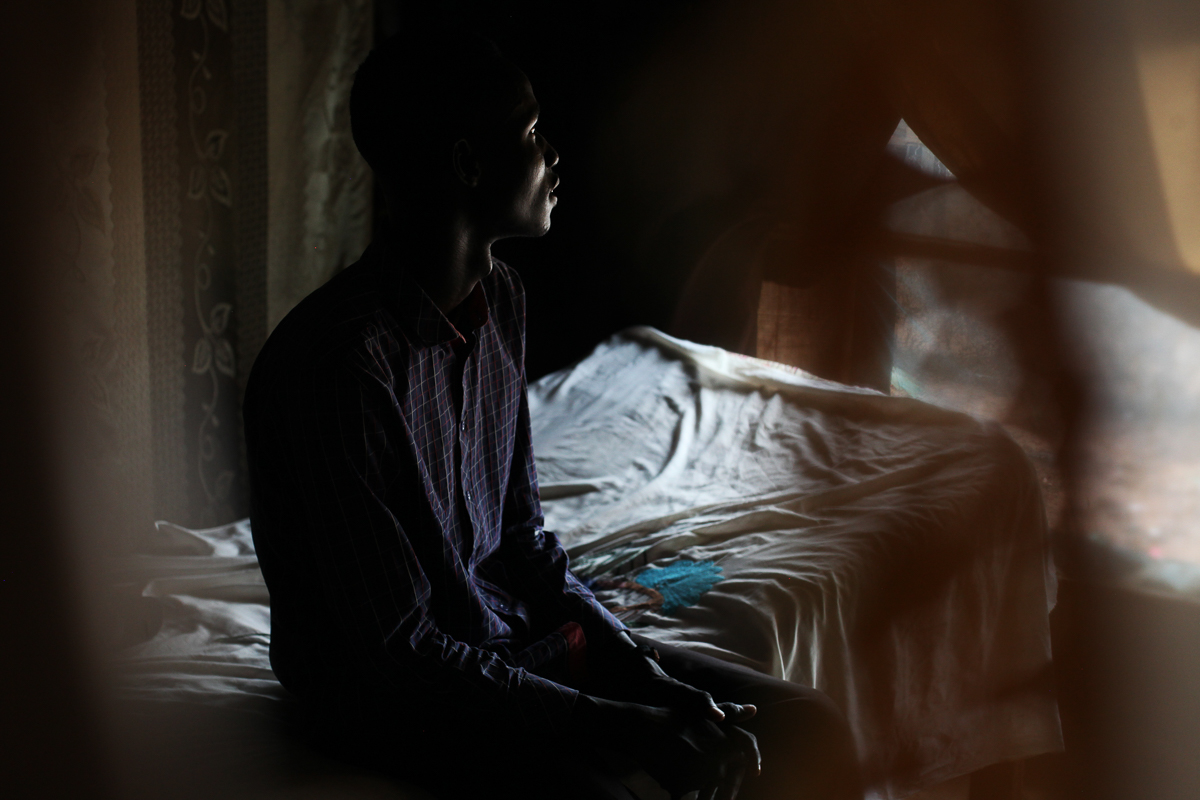 Y, 18, in his home in the POC in Juba, where he has been living since January 2018. He was going to school in Malakal when the war started. He fled to a village in Fangak where his family is originally from. 'When the enemy attacked us, I decided to join because I was angry. They killed old people, children, disabled people who could not escape. One of my cousins was killed. I knew that if they reach our village, they would kill my family, destroy our properties. I thought, it's better if I die fighting them then let them kill my parents.' At the beginning of this year, he asked to go to Juba. 'I didn't want to be there anymore. The soldiers on both sides, it's not them, they could shake hands. But the big people make them fight.' [Andreea Campeanu/Al Jazeera]