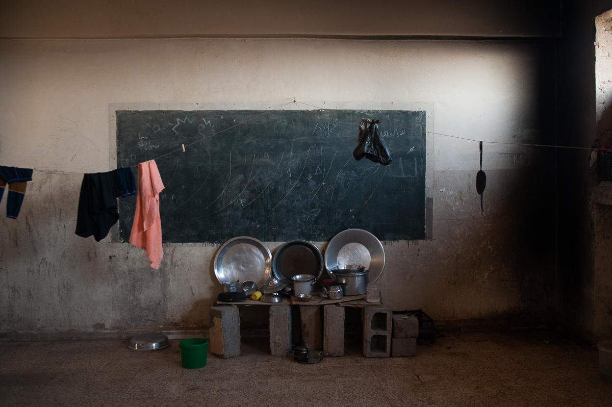 A classroom converted into an apartment in the abandoned school of Harijieh. The diet of IDPs is mainly based on bread and tea. [Linda Dorigo/Al Jazeera]