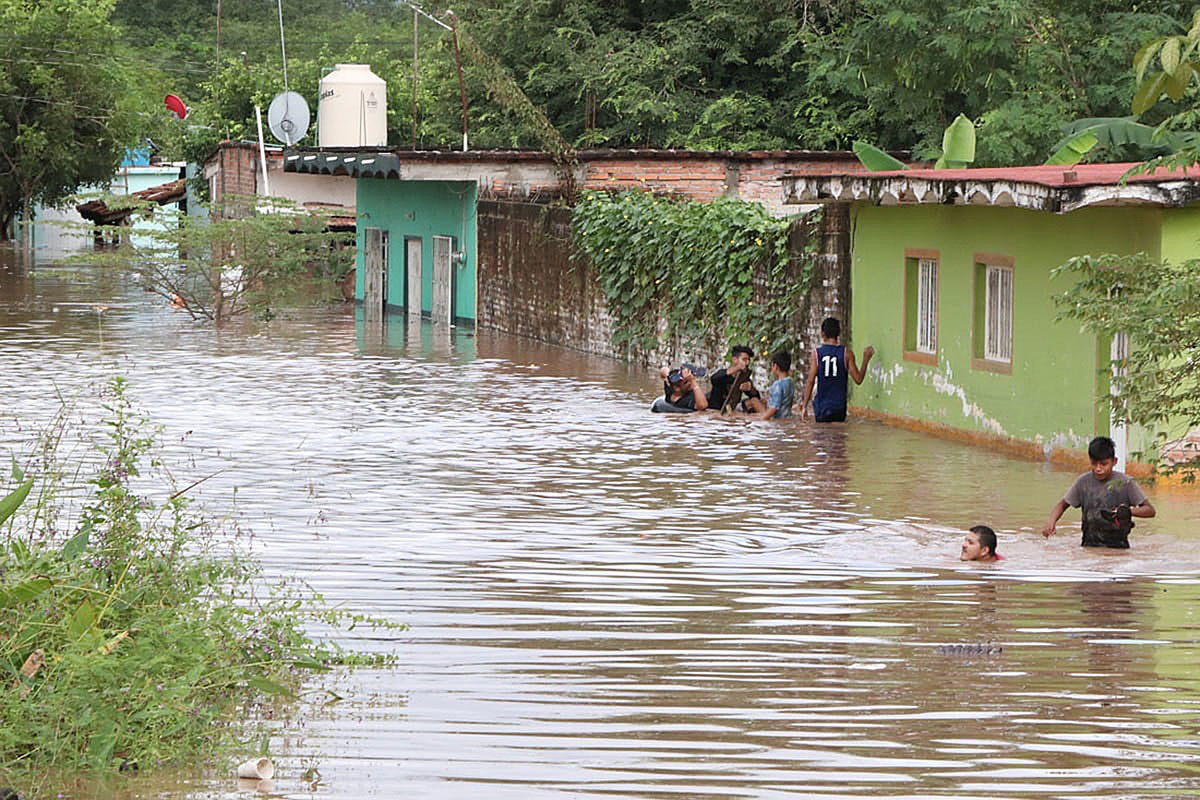 Hurricane Willa flooded this town in Nayarit state, Mexico. The remnants of the storm then moved into the southeastern US and became a nor'easter. [Aaron Garcia/EPA]
