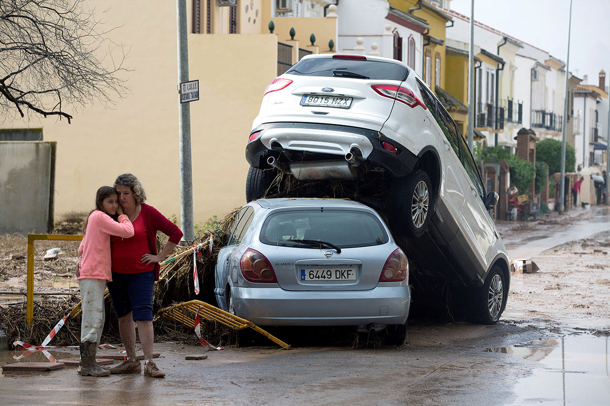 Torrential rain and flooding was enough to pile car upon car in Malaga, Spain. [Daniel Perez/EPA]