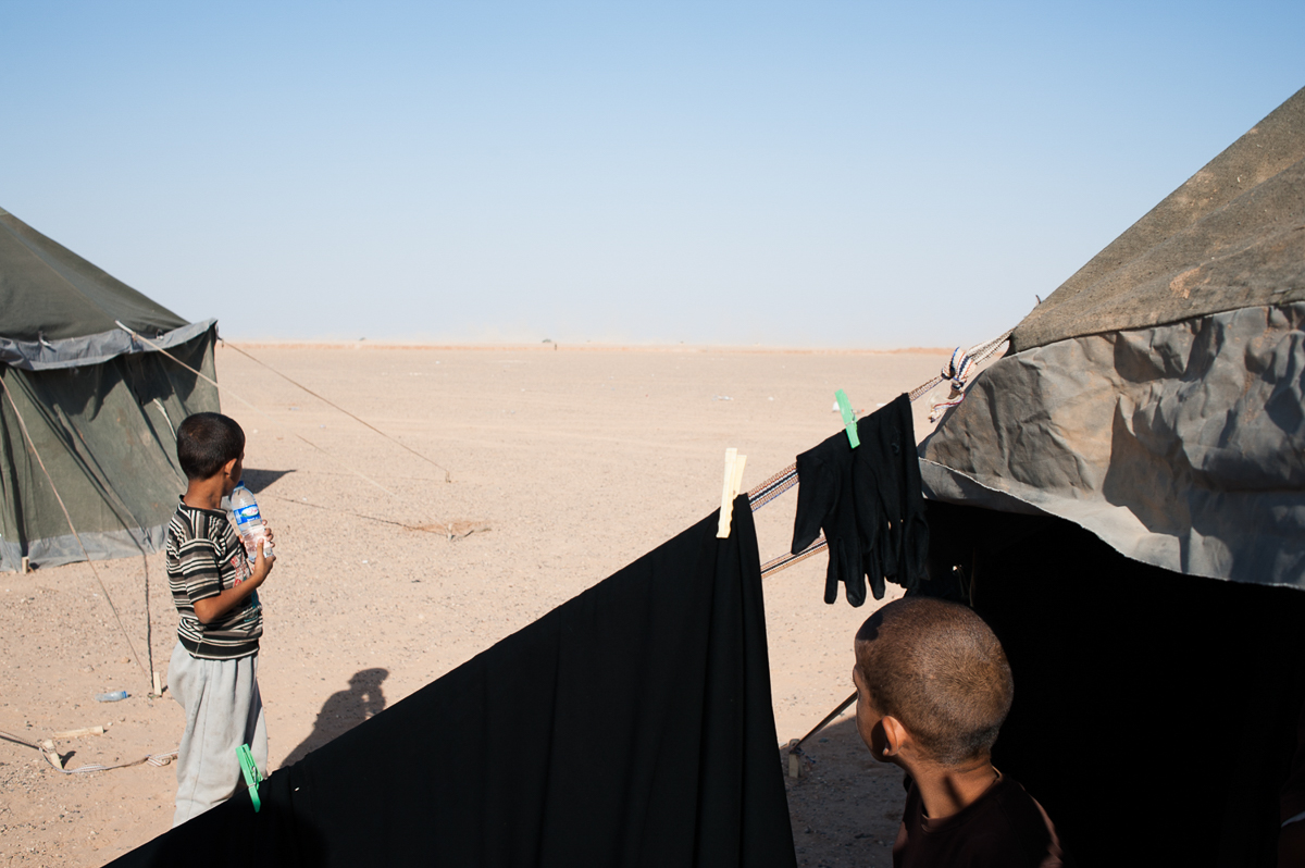 The living conditions in the Hajin camp are difficult. 'The war is close to inhabited areas, if the influx will continue we will need thousands of tents,' said Mohammed, who is managing the camp. He fears the number of IDPs is growing too fast to offer them dignified shelter. [Linda Dorigo/Al Jazeera]