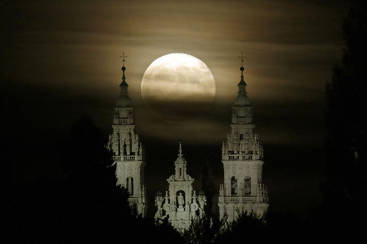 A full moon, a touch of clouds and the Santiago de Compostela Cathedral all make for a picture perfect shot, Galicia, Spain. [Lavendeira Jr/EPA]