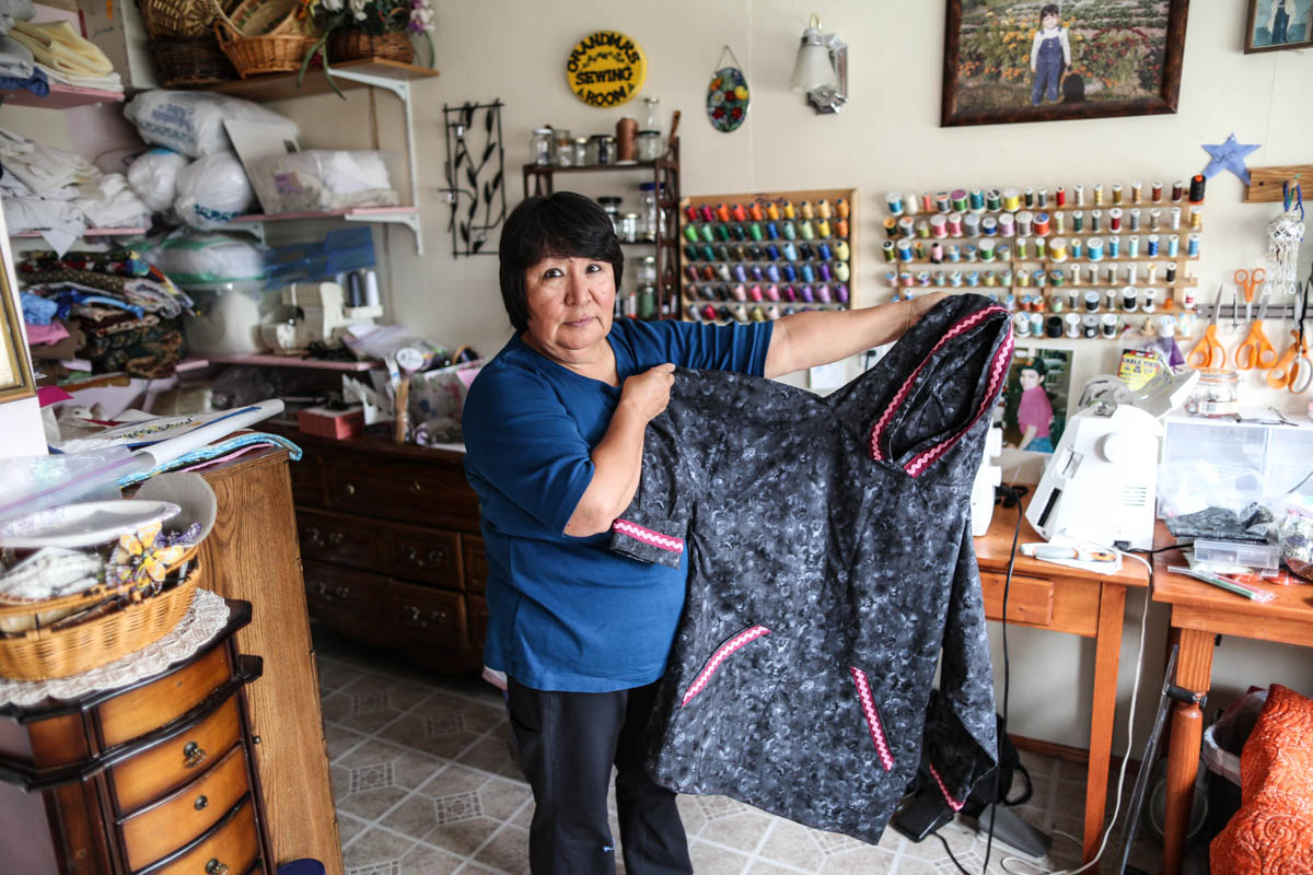 Funa is part of a growing cottage industry of Alaskans - both Native and non-Native - who have begun sewing and selling kuspuks in their communities or online. [Showkat Shafi/Al Jazeera]