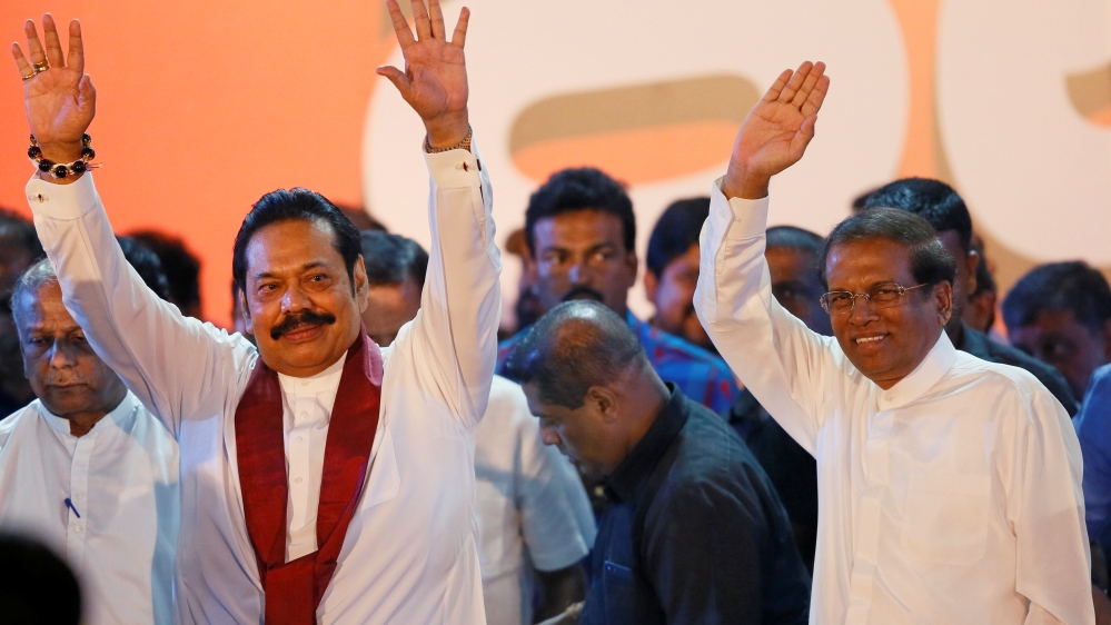 Sri Lanka's prime minister returns, but 'crisis is far from over'