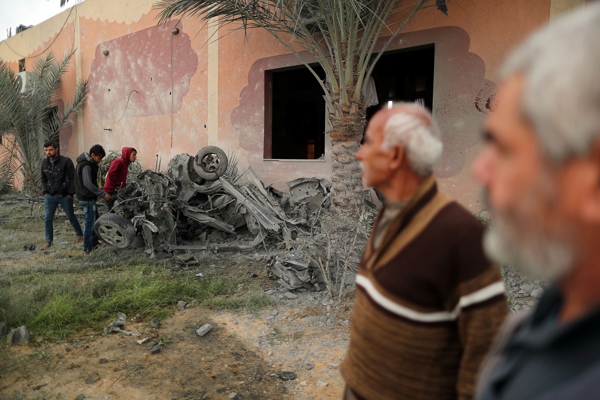 The scene of Israeli air attack in Khan Younis. Israeli forces killed seven Palestinians in the besieged enclave in a clandestine raid targeting a Hamas commander. [Suhaib Salem/Reuters]