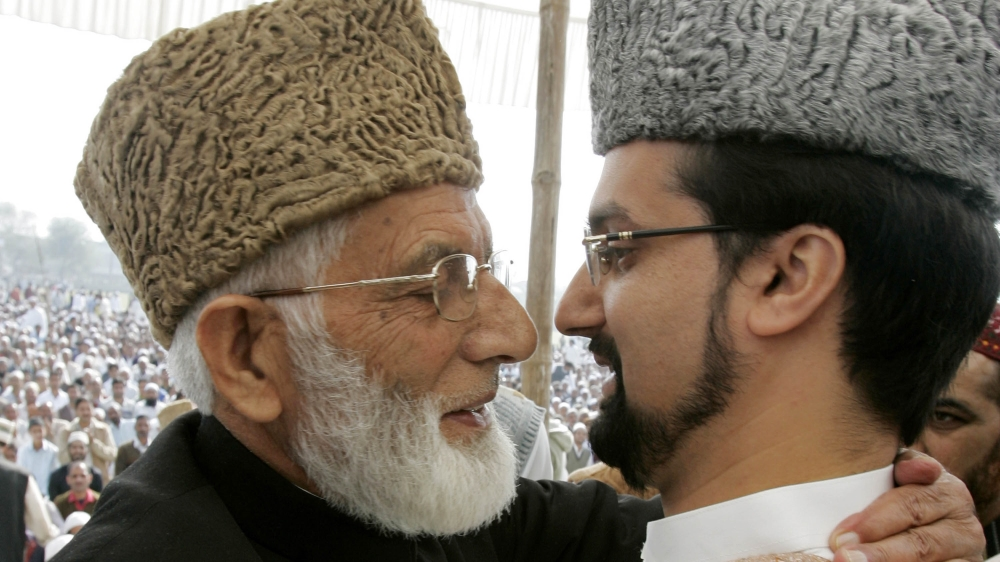 Mirwaiz Umar Farooq, (R) Chairman of Kashmir's moderate faction of All Parties Hurriyat (Freedom) Conference (APHC), and Syed Ali Shah Geelani Chairman of the hardliner faction of APHC hug on the occ
