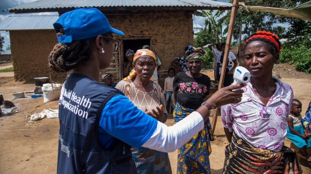 A WHO official talks to local women in DR Congo as part of the effort to fight Ebola