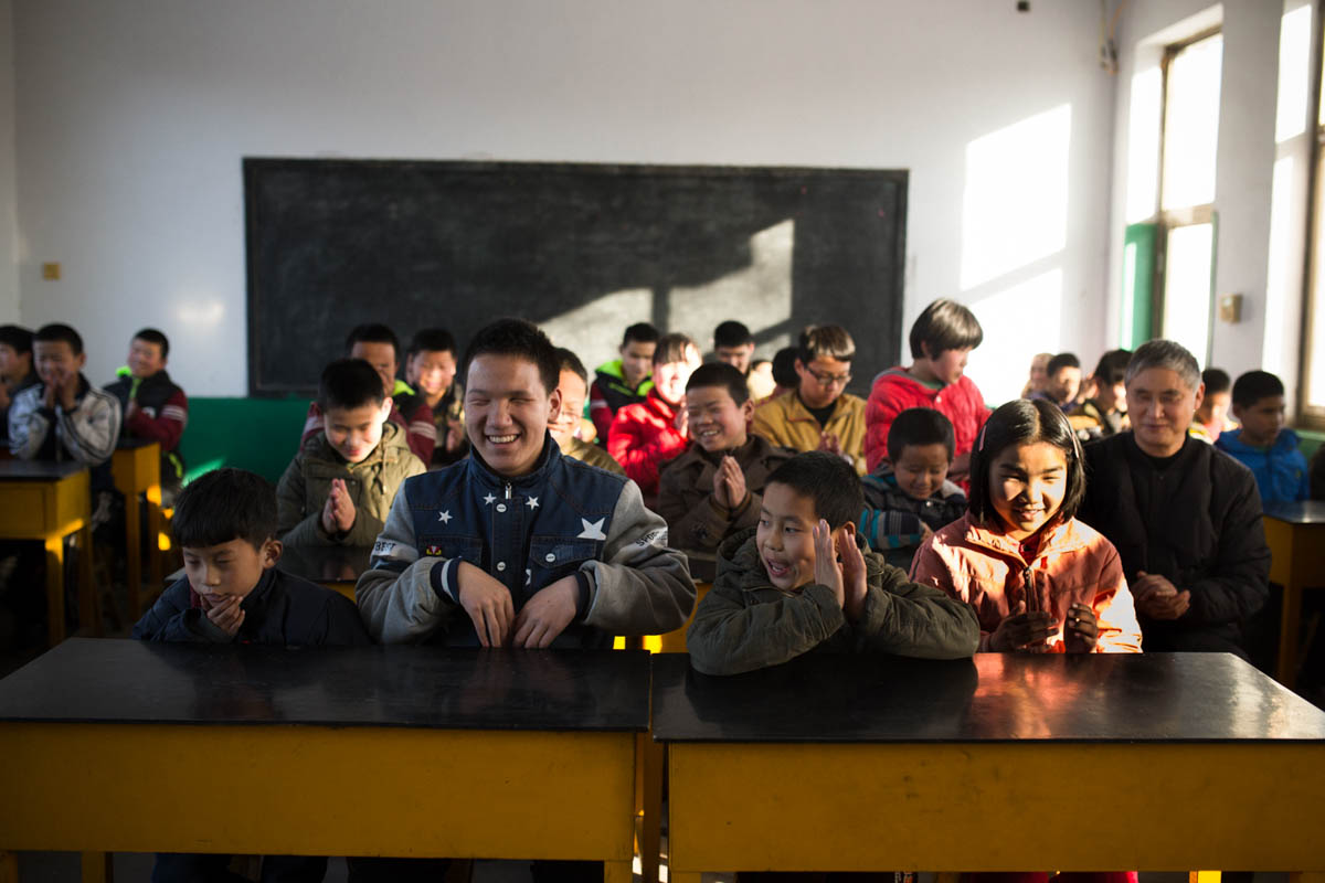 Students at Mu Mengjie School for the Blind gather for singing class. Music is incredibly important at the school and the children and teachers gather to sing and play several times each day. [Nathan Gibson/Al Jazeera]