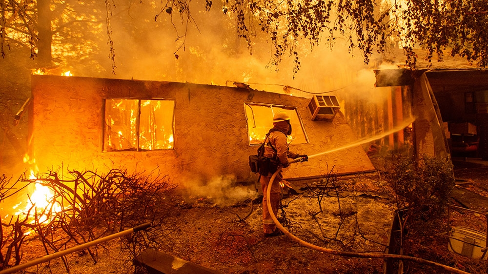 California wildfires: Death toll rises to 25 as blazes continue thumbnail