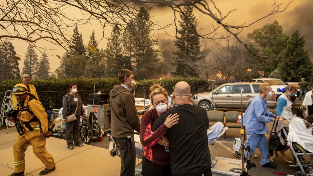 Raging California wildfires kill 9, force thousands to flee