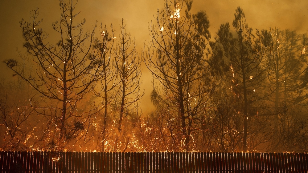 Tens of thousands of people fled a fast-moving wildfire Thursday in Northern California