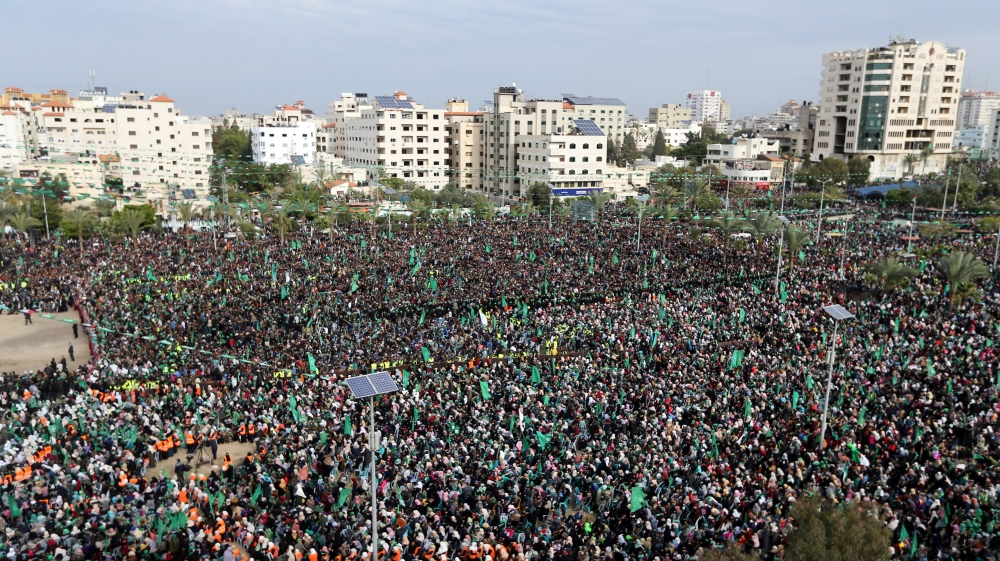 Palestinians in Gaza take part in a rally marking the 31st anniversary of Hamas founding