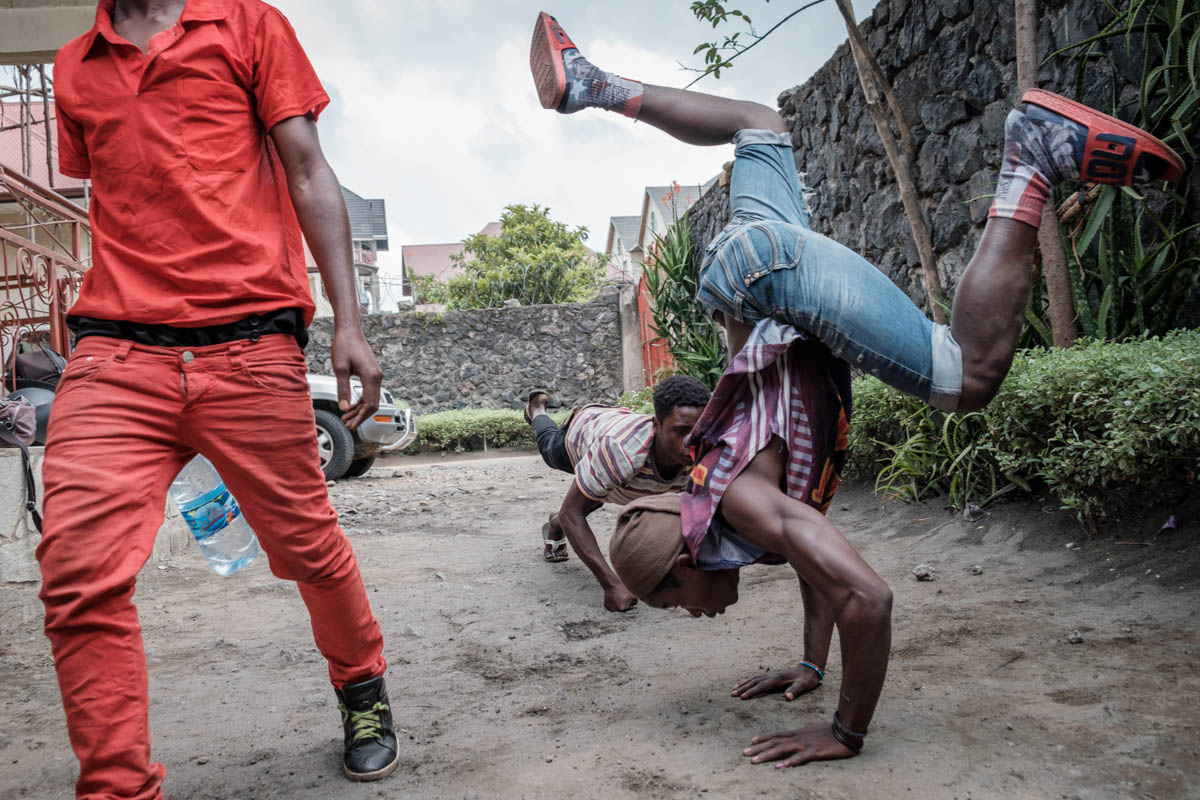 Members of the hip-hop collective Shusha Ma Flow practise their dance moves during a break at a recording studio in Goma. [Nathalie Bertrams/Al Jazeera]
