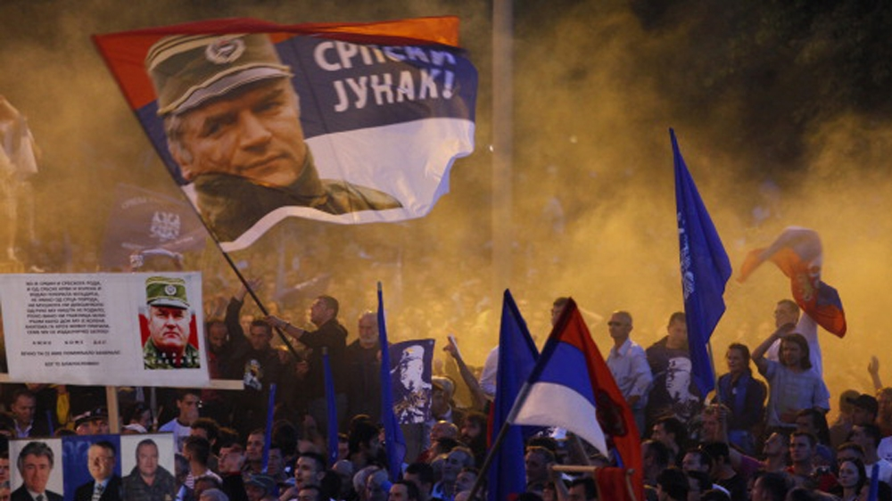Pro-Mladic Supporters Showed In Belgrade BELGRADE, SERBIA - MAY 29: Supporters of the Ratko Mladic wave flag her image and reading on Serbian & # 39; heroes of Serbia & # 39; in a rally organized