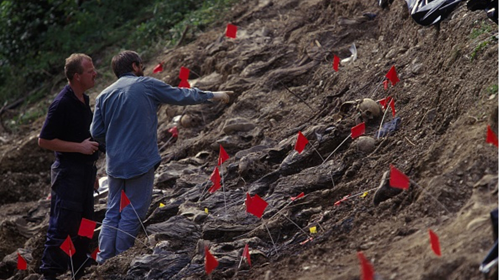 Mass Grave Exhumation near Cerska SREBRENICA, BOSNIA AND HERZEGOVINA - JULY 1996: Mass grave exhumation near Cerska, a year ago the Bosnian Serb army, led by General Ratko Mladic,