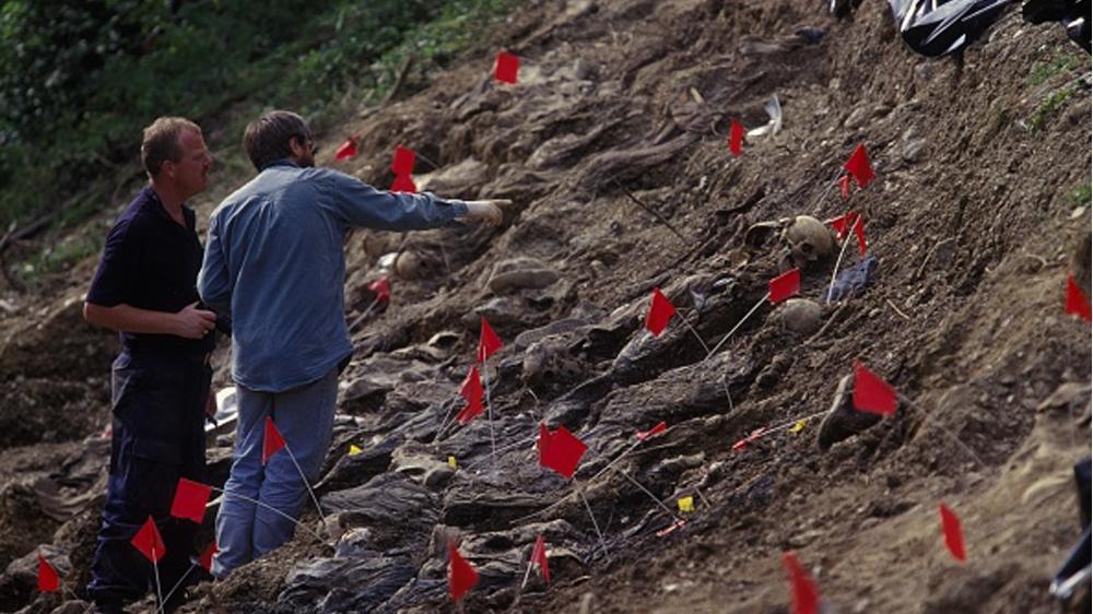 Mass Grave Exhumation near Cerska SREBRENICA, BOSNIA AND HERZEGOVINA - JULY 1996: Mass grave exhumation near Cerska, a year ago the Bosnian Serb army, led by General Ratko Mladic,