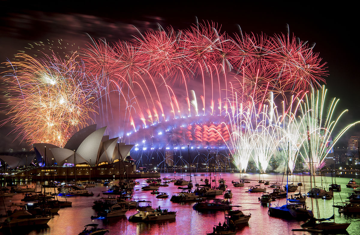 Fireworks explode over the Sydney Harbour during New Year's Eve celebrations. [Brendan Esposito/AAP/AP Photo]