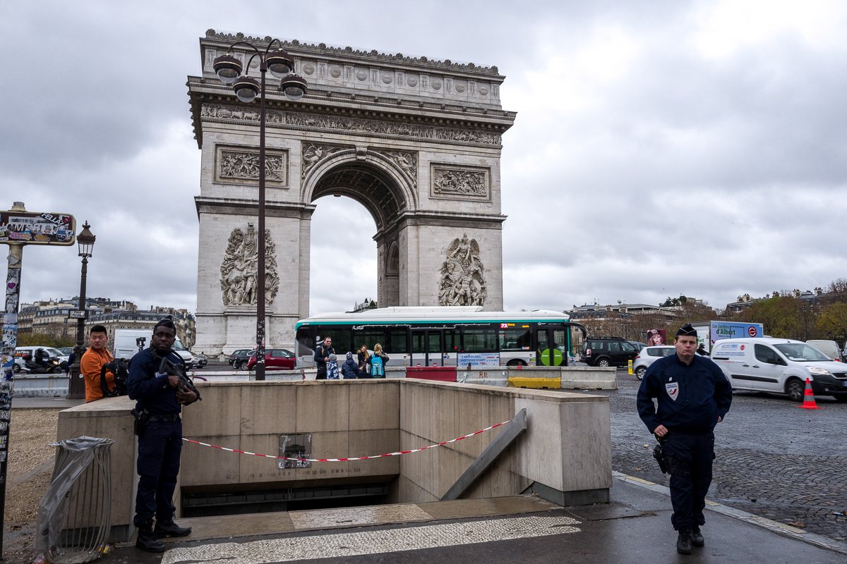 French Police guards the access to the world famous Arc de Triomphe, closed to the public after being vandalised during last Saturday's protest. Protesters smashed a statue of Marianne, the symbol of the French Republic, on display at the entrance, broke displays in the interior of the monument, and graffitied slogans on its walls. [Omar Havana/Al Jazeera]