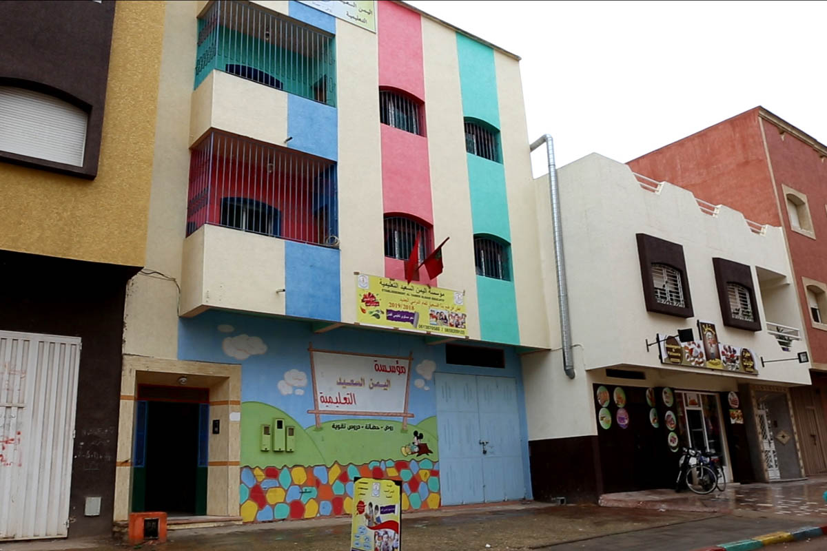 Hope kindergarten is located in a residential block in Kenitra, about 50km from the capital, Rabat. Its brightly painted walls make it stand out from neighbouring buildings. [Faras Ghani/Al Jazeera]