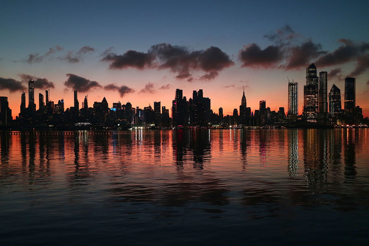 A beautiful sunrise begins the day over midtown Manhattan, New York. [Gary Hershorn/Getty Images]
