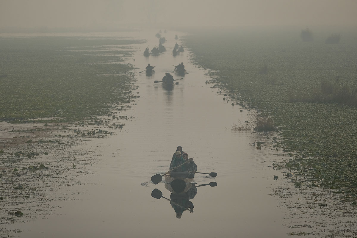 Srinagar, India's Dal Lake was shrouded in a cold fog. Authorities closed schools for winter vacations last week because of the cold. [Mohd Samsul Mohd Said/Getty Images]
