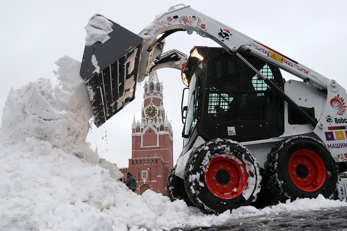 Familiar sights in Moscow's Red Square have been competing with piles of snow left by strong winter storms this week. [Vyacheslav Prokofyev/Getty Images]