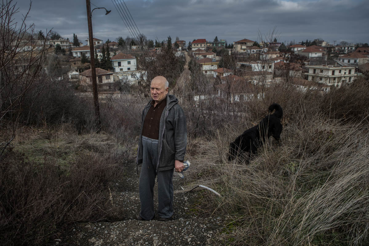 Aristokratis is one of the last 10 residents of Mavropigi, a village ready to be demolished for coal extraction. Even though PPC have officially relocated Mavropigi's residents, a few still live in the village. 'We get paid to die,' he says. [Anna Pantelia/Al Jazeera]