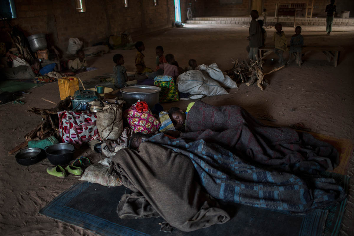 IDPs sleeping on the floor of Saramandja Church try to stay warm with blankets. The majority of those displaced recently in Ouham-Pende prefecture are women and children; the latter are said to make up 60 percent of IDPs in Paoua. [Will Baxter/ Al Jazeera]