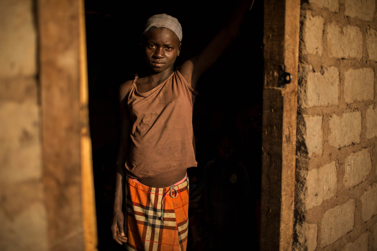 Abigaelle Benonkoumte, 13, stands in the doorway of a previously abandoned house that she and her extended family have taken shelter in in Paoua town after fleeing violence in late December when the MNLC attacked Beboy Label village. [Will Baxter/ Al Jazeera]