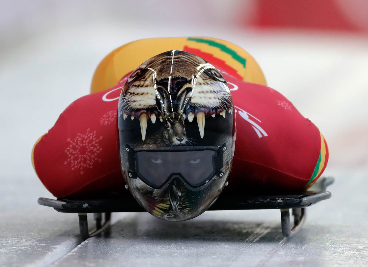 Akwasi Frimpong of Ghana starts his practice run during the men's skeleton training at the 2018 Winter Olympics in Pyeongchang, South Korea. Frimpong is the first West African to compete in the skeleton competition. [Wong Maye-E/AP Photo]