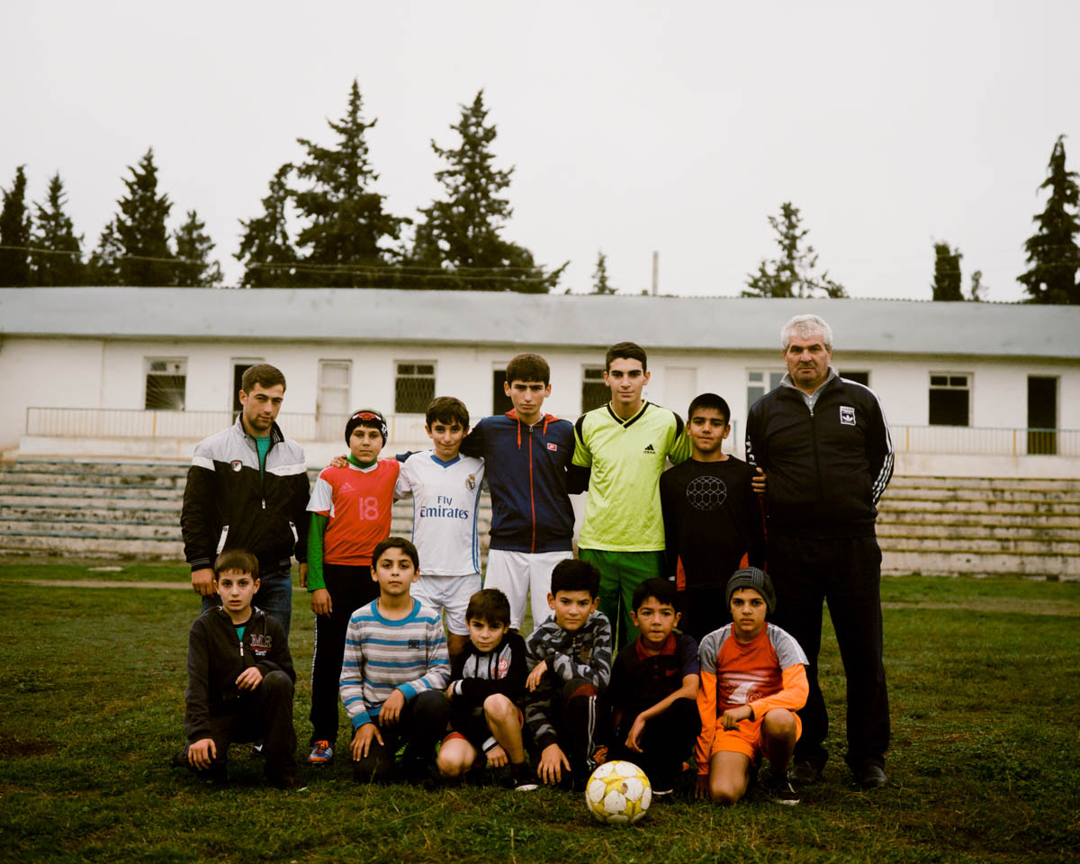 The football team in Matakert, minus some players who were away in the army.Conscription is compulsory for all 18-year olds unless they have a health problem that prevents them from fighting. [Gus Palmer/Al Jazeera]
