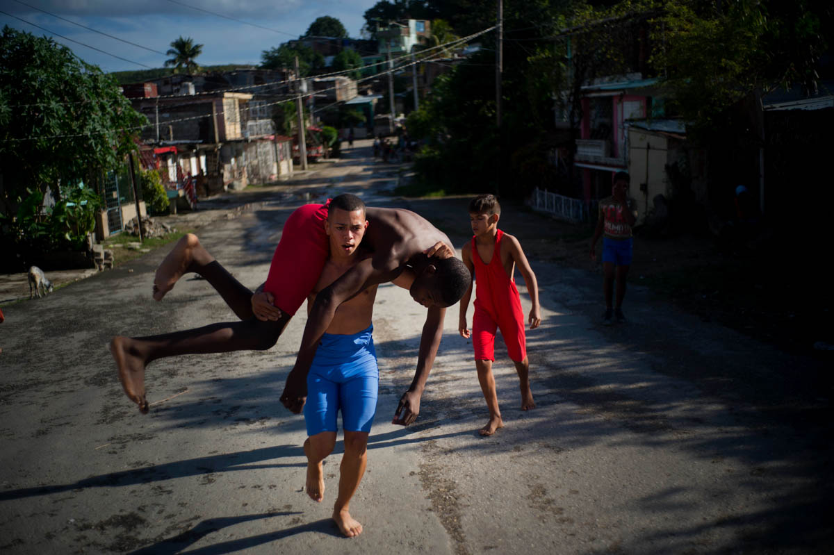 Young wrestlers train in Cuba's streets during the week-long student wrestling championship coined 'The truth of my neighbourhood', organised by locals in the Chicharrones neighbourhood of Santiago. [Ramon Espinosa/AP Photo]