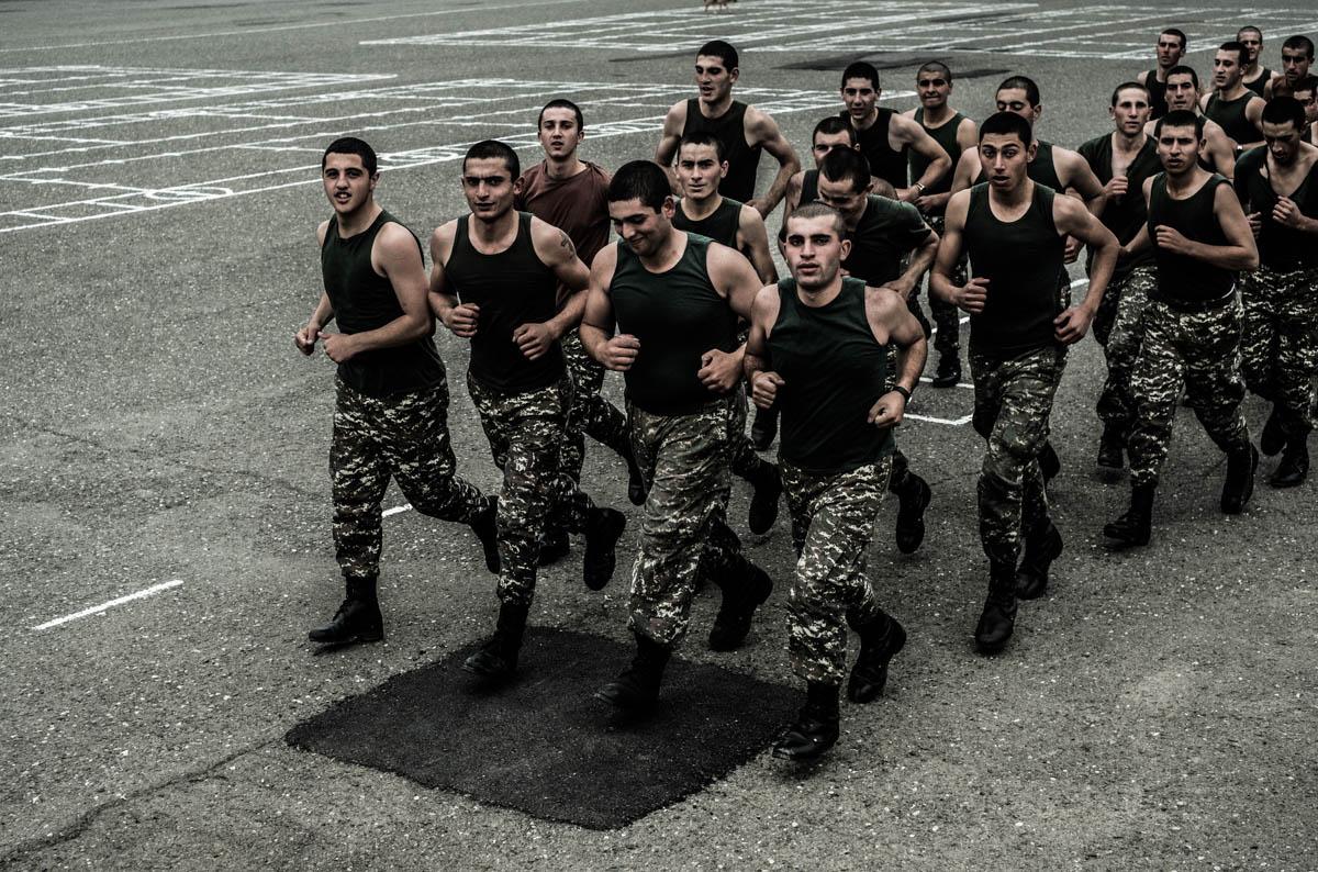 Conscripts run laps in the yard of a military base in Martuni. [Gus Palmer/Al Jazeera]