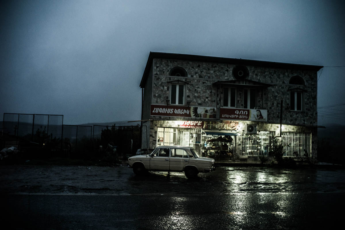 A car outside a supermarket in the town of Martuni.During the recent escalation in fighting in April 2016, many residents wanted to stay put, although many say they could hear the exchange of fire happening within the village.[Gus Palmer/Al Jazeera]