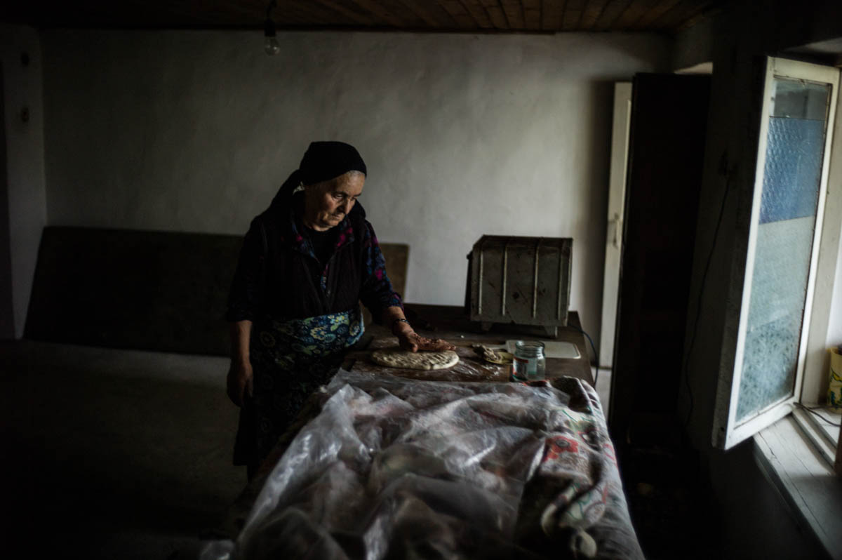 Lena and Edik Grigoryan's village is in the firing line of Azerbaijan. On a clear day, you can make out enemy positions in the distance. Lena remembers when they lived side by side in harmony with Azerbaijanis, and speaks the Azeri language fluently. [Gus Palmer/Al Jazeera]