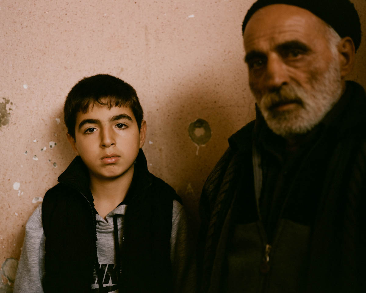 Armin and his grandfather at their home in Martakert. His father was killed while serving on the frontline. His grandfather fought in the war in the early 1990s. [Gus Palmer/Al Jazeera]