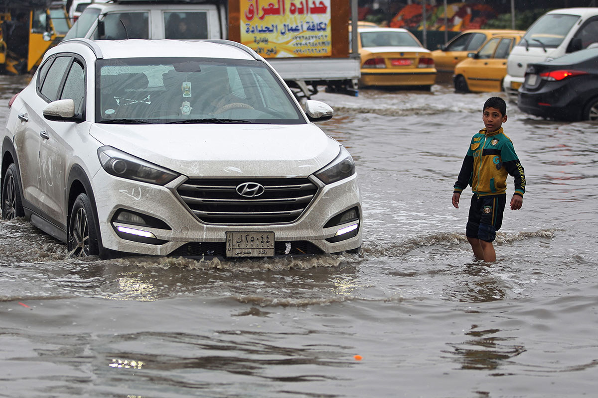 Baghdad's streets are well washed after heavy rainfall in Iraq. [Ahmad al-Rubaye/AFP]