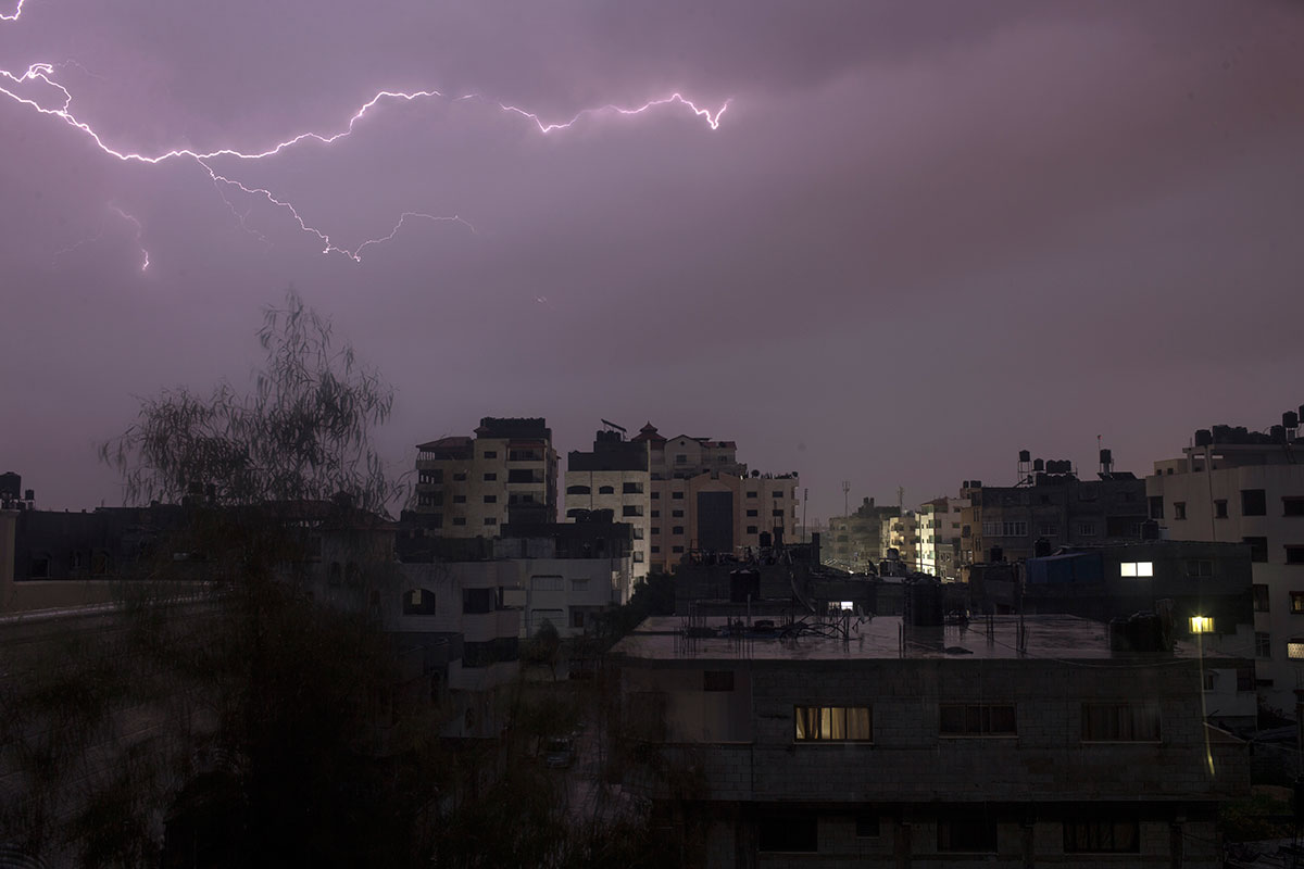 Lightning over Gaza City on Saturday during an early morning thunderstorm. [Mohammed Abed/AFP]