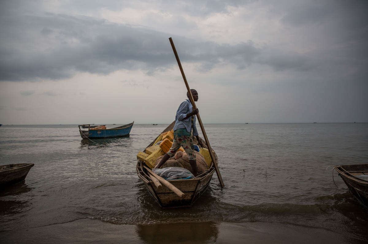 Refugees flee Congo across Lake Albert in small, over-packed canoes and flimsy fishing boats. It takes up to 10 hours to make the perilous journey. Several refugees have already drowned attempting the crossing. [Ingebjorg Karstad/Norwegian Refugee Council]