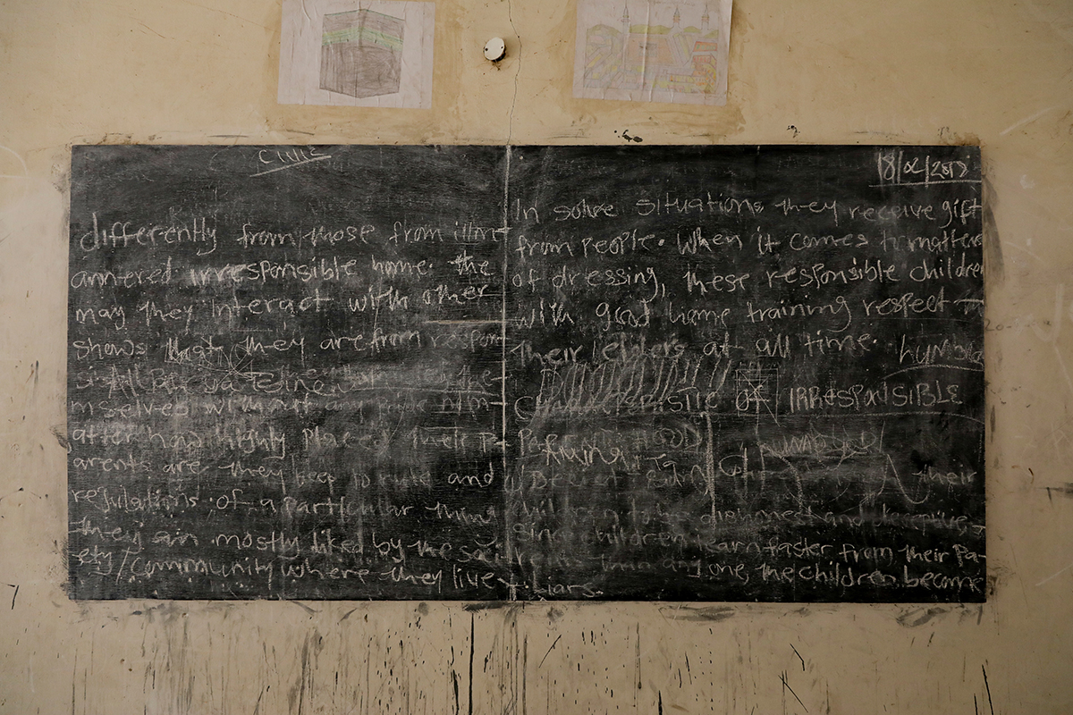 Messages daubed on walls, blackboards and rows of empty bunk beds provide a glimpse of school life. [Afolabi Sotunde/Reuters]