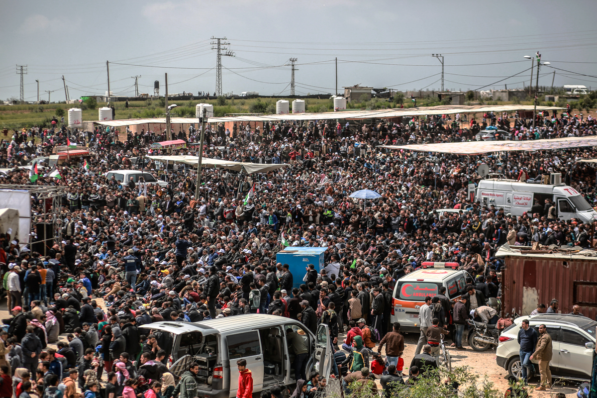 Friday noon prayers took place in the Malka area east of Gaza city with the presence of Palestinian political leaders, including Hamas' Ismail Haniya [Hosam Salem/Al Jazeera]