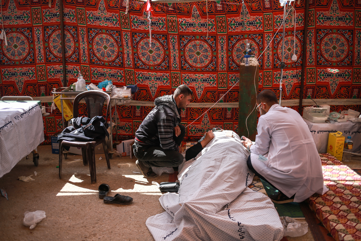 A makeshift field clinic to treat those wounded during the protest. [Hosam Salem/Al Jazeera]