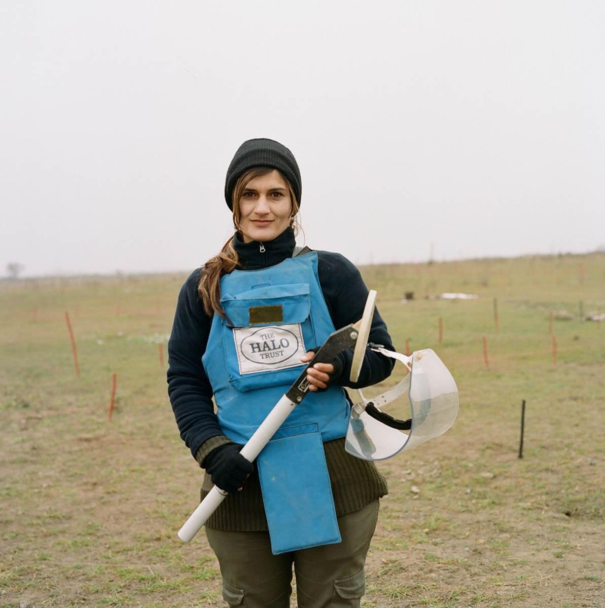 Alvina, one of HALO's female de-miners at Marzili. [Eva Clifford/Al Jazeera]