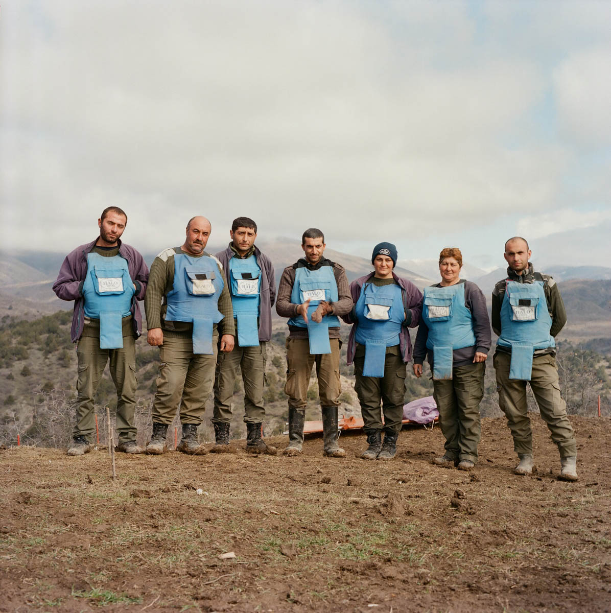 A HALO de-mining team at the Aghavnatun minefield. Once they have finished their work here, the land can be used safely again for multiple purposes - from grazing livestock to being a place where local kids can play and wander without fear. [Eva Clifford/Al Jazeera]