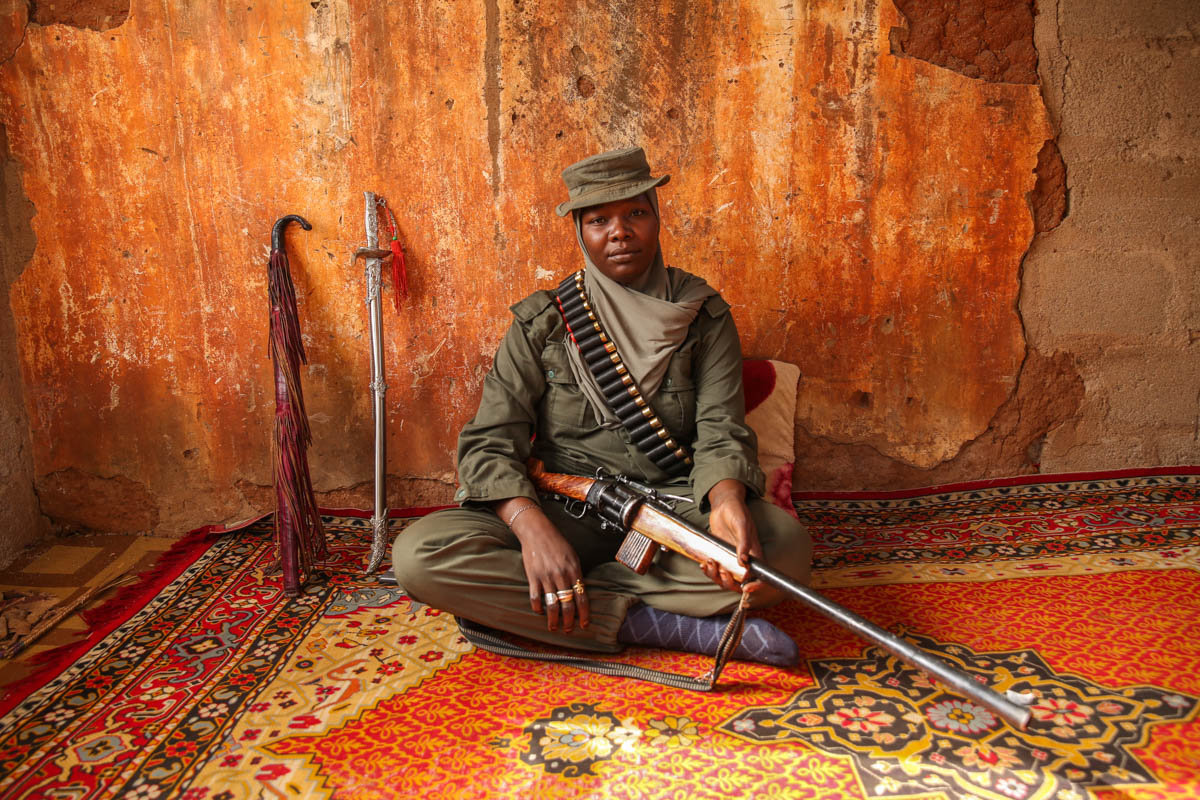 Aisha grew up hunting antelopes and water buffalo with her father. Now she hunts Boko Haram fighters. [Rosie Collyer/Al Jazeera]