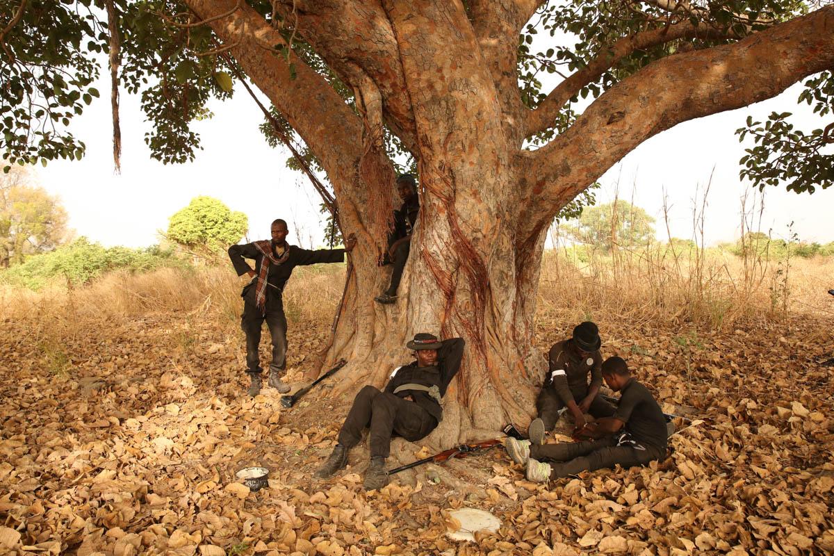 Aisha and hunters under her command take a break from tracking Boko Haram deep inside Sambisa Forest. [Rosie Collyer/Al Jazeera]