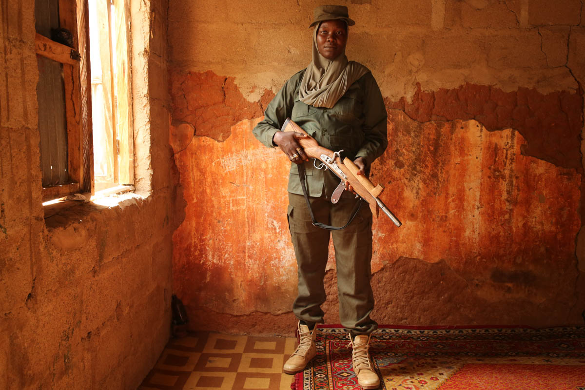 Hunters mainly use locally-made weapons in their fight against Boko Haram. [Rosie Collyer/Al Jazeera]