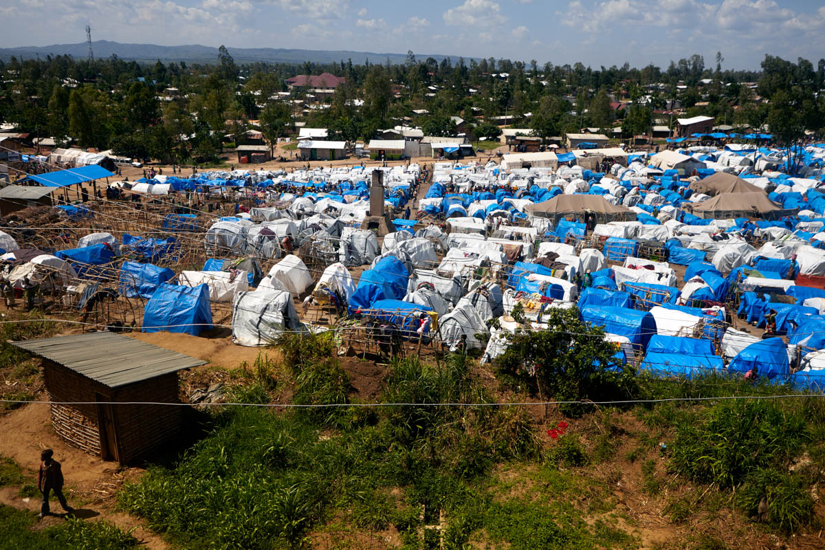 A refugee camp in the centre of Bunia. With the first groups of refugees having come from the nearby Djugu territory to settle here in February, there are now approximately two thousand living in the camp. [Alex Mcbride Wilson/Al Jazeera]